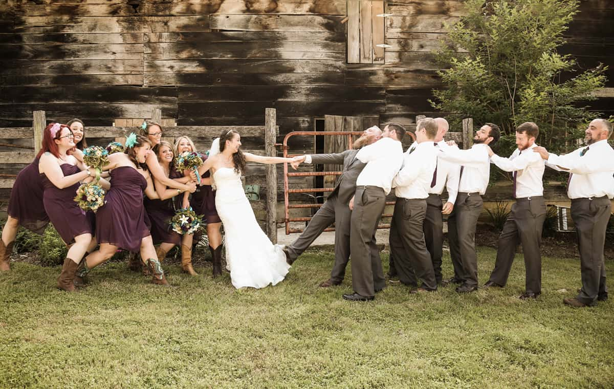 bridesmaids and groomsmen tug of war