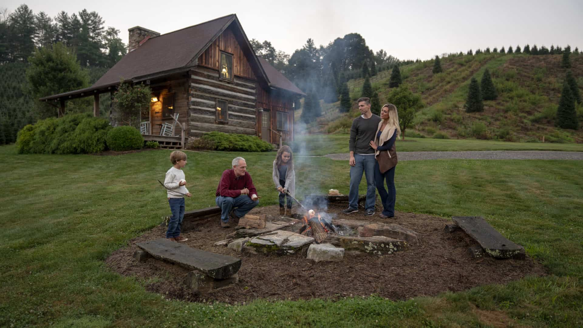 Family gathered around the fire at a Boyd Mountain cabin
