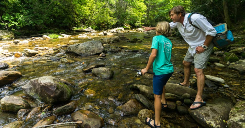 Father and son fishing at Sunburst Swimming Hole in the NC Smoky Mountains.
