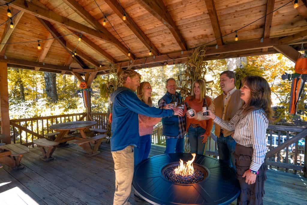 Family toasting creekside at Jonathon Creek Inn in Maggie Valley, NC
