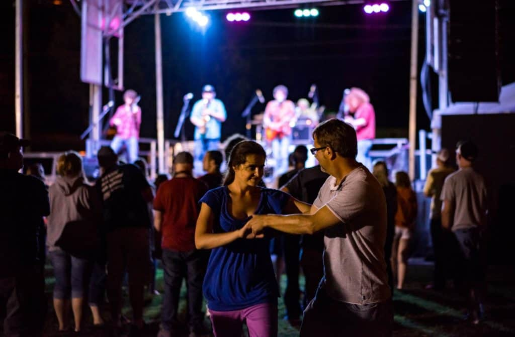 Couple dancing in the crowd at a music festival in Haywood County.
