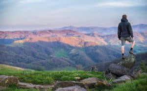Hiker admiring a view of the Great Smoky Mountains.