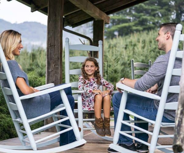 Family on the porch at Boyd Mountain Cabins in Waynesville, NC