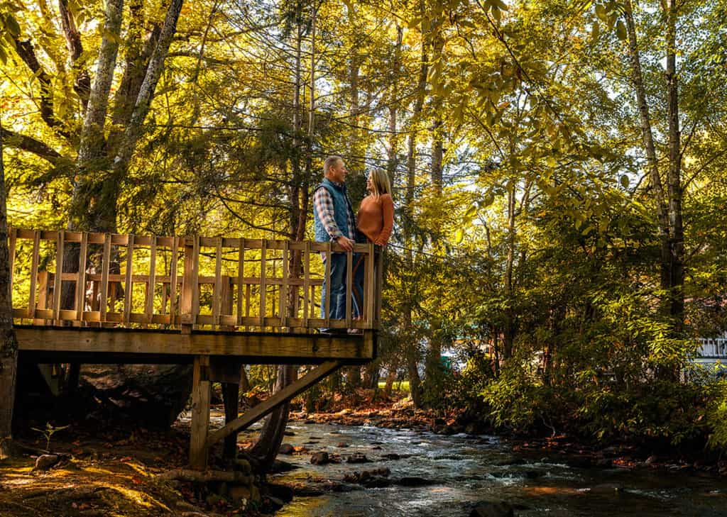 Couple spending a romantic afternoon creekside in Maggie Valley, NC.