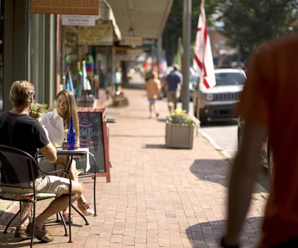 Couple eating outdoors in Downtown Waynesville, NC
