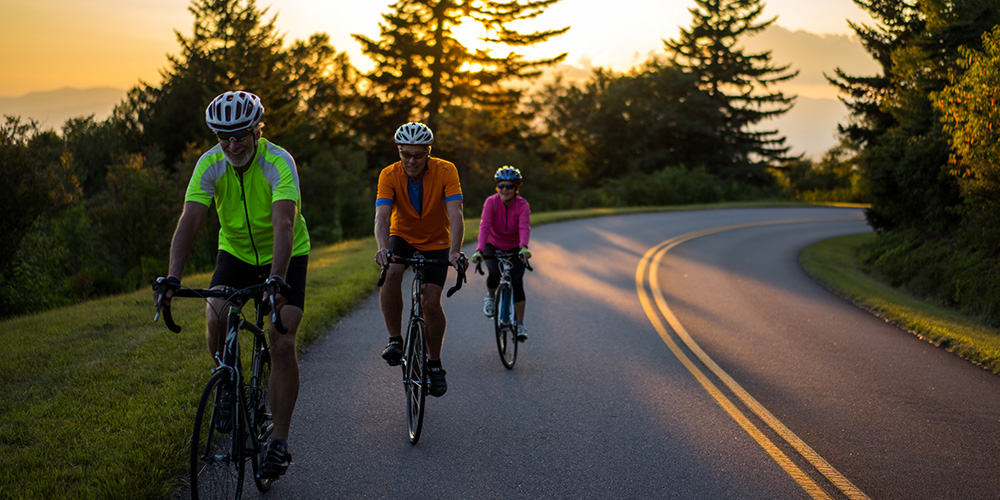Mountain Bikers Riding at Sunset